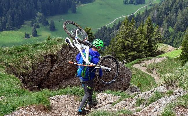 man carrying his bike