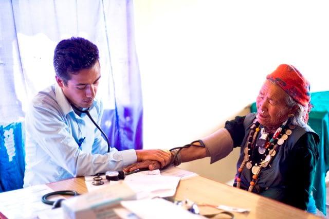 doctor checking old man